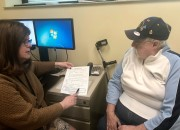 Pharmacist Angela Pentecost sits with Navy Veteran Michael Parker and reviews his bloodwork